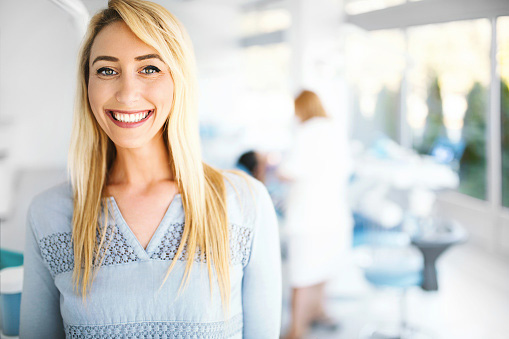 Young female patient smiling after leaving a positive review for Atlantic Dentistry in Jacksonville, FL